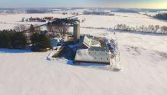 Vast snow covered Wisconsin landscape with farms and silos Stock Footage