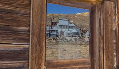 Reflection of old factory in Bodie - stock photo