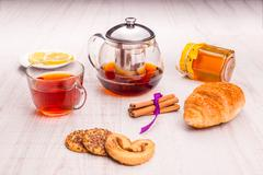 Tea in a transparent cup, cinnamon and oat cookie Stock Photos