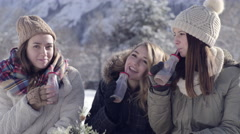 Closeup Of Teens Enjoying Winter Holidays, They Sip Hot Cocoa And Turn And Smile Stock Footage