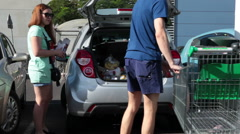 Family getting car after visiting food market, Tenerife, Spain Stock Footage