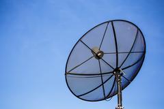 Satellite dish on the roof sky background Kuvituskuvat