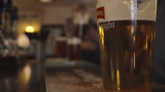 Bartender Pulling A Pint In A British Pub - stock footage