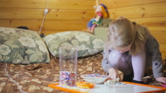 Close up portrait of little cute girl play mosaic Stock Footage