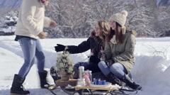 Teens Enjoy Hot Chocolate, Their Friend Joins Them And They Share With Her Stock Footage