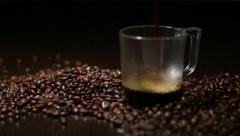 Pouring coffee into cup. Coffee beans  and cup with coffee Stock Footage