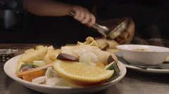 Serving up some pub grub in a British pub. - stock footage