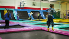 Kids playing jumping on a trampoline playgroung Stock Footage