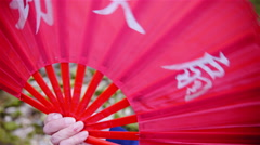 Opening red Chinese fan and covering whole frame 4K Stock Footage
