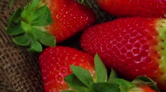 Ripe juicy strawberries on jute sackcloth Stock Footage
