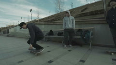 Man makes a few tricks on a skateboard in the outdoor Stock Footage