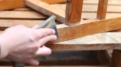 Stock Video Footage of Restoring furniture. Paint stripping