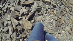 Girl goes on the small crumbly stones in the mountains, first-person view Stock Footage