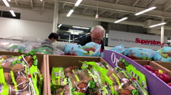 Man selecting grape in grocery store produce department Stock Footage