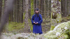 Martial arts woman warrior making exercise forms in middle of forest 4K Stock Footage
