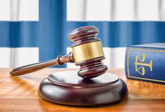 A gavel and a law book - Finland - stock photo