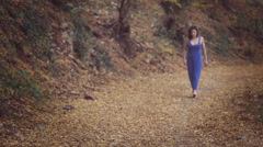 Barefoot woman in a natural path seems to have lost  her way Stock Footage