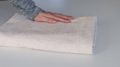Fold towels on white table Stock Footage