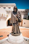 Statue of Francois Grimaldi disguised as a monk with a sword und Stock Photos