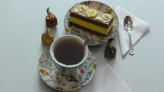 Sponge cake and a cup of tea Stock Footage