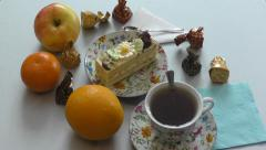 Sponge cake and a cup of tea - stock footage