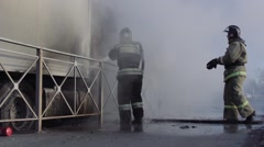 Firefighters extinguish a truck - stock footage