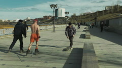 Man riding a roller shirtless on the waterfront Stock Footage