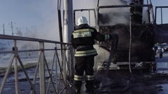 Russian Firefighters extinguish a truck on road Stock Footage