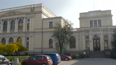 Panoramic view of National museum and parked cars in Sarajevo Stock Footage
