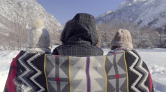 Friends Wrapped In Blanket Look Out At Beautiful View Of Snowy Utah Mountains Stock Footage