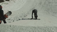 Snowboarder preparing springboard Stock Footage