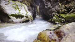 River in Slovenia flow through mountain rocks slide over 4K Stock Footage