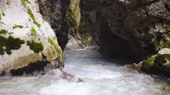 River in Slovenia running under rocks mountain creek, tranquil environment 4K Stock Footage