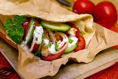 Tortilla wrap with chicken breast and vegetables. - stock photo
