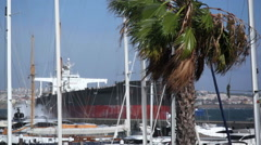 Strong winds, container ship crashed on Cascais yacht marina, Portugal Stock Footage
