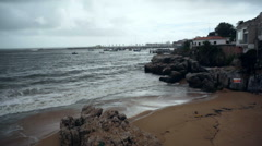 Waves crash into coast, Atlantic ocean, Cascais harbor port, Portugal Stock Footage