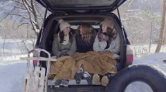 Teens Warm Up And Chat In Car After Sledding In Utah Mountains Stock Footage