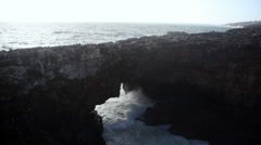 Strong extreme waves crash into grotto cliff cave, Boca do Inferno, Portugal Stock Footage