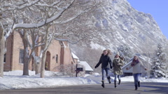 Teens Run, Jump And Twirl Toward Camera, In Beautiful Snowy Neighborhood Stock Footage