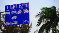 Road sign regulating vehicle moving on traffic lanes Stock Footage