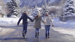 Teenage Friends Hold Hands And Walk Down Road Together In A Winter Wonderland Stock Footage