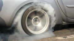 Drag racing car burns rubber off its tires Stock Footage
