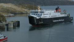 Caledonian MacBrayne ferry leaving the port of Tarbert, Scotland Stock Footage