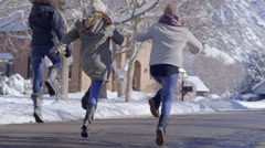 Carefree Teens Skip Down A Neighborhood Road On A Beautiful Winter Day Stock Footage