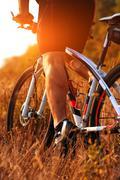 Cyclist riding mountain bike on rocky trail Stock Photos