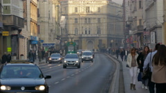 Tram, cars and people on Maršala Tita street in Sarajevo Stock Footage
