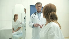 Upset woman on a medical examination Stock Footage