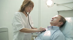 Mature man on the medical examination Stock Footage