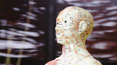 Doll head with marked energy meridians close up 4K Stock Footage