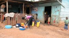 Local woman doing washing laundry in the Jinja, Uganda. Stock Footage